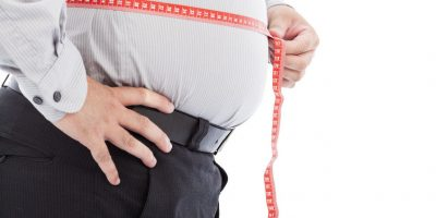 28997574 - fat business man use scale to measure his waistline